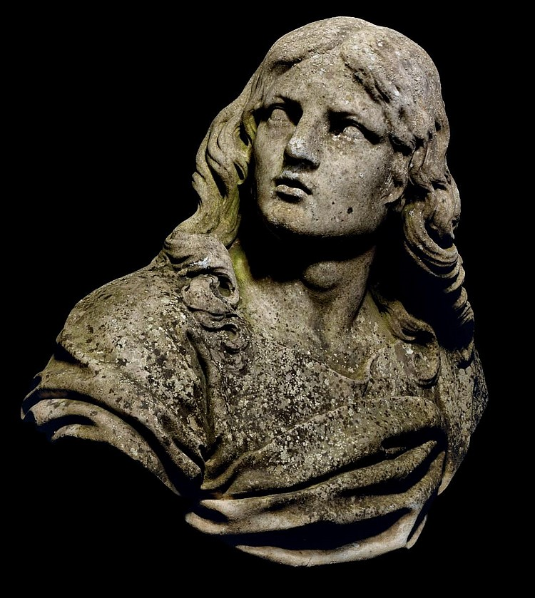 A CARVED MARBLE BUST OF A YOUNG MAN, POSSIBLY ST. JOHN THE EVANGELIST