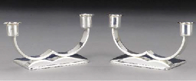 A PAIR OF WHITE METAL CANDLESTICKS