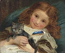 A little girl with a kitten