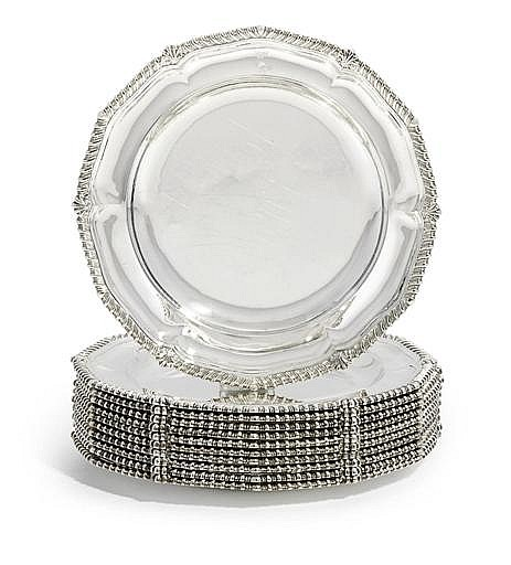 A SET OF EIGHT GEORGE IV SILVER DINNER-PLATES