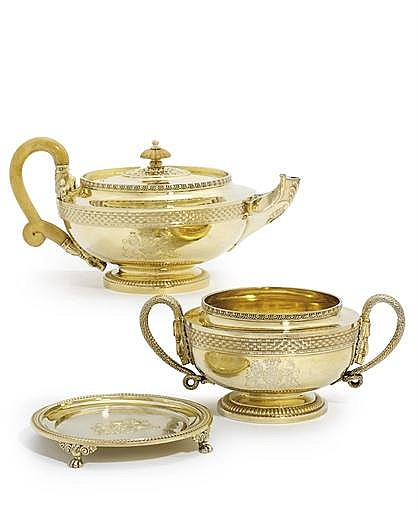 A GEORGE III SILVER-GILT TEAPOT, STAND AND SUGAR-BOWL