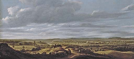 An extensive landscape with huntsmen resting on a path, a town beyond