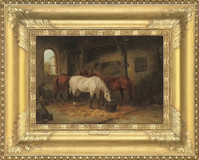 Three horses in a stable