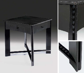 An ebonised centre table