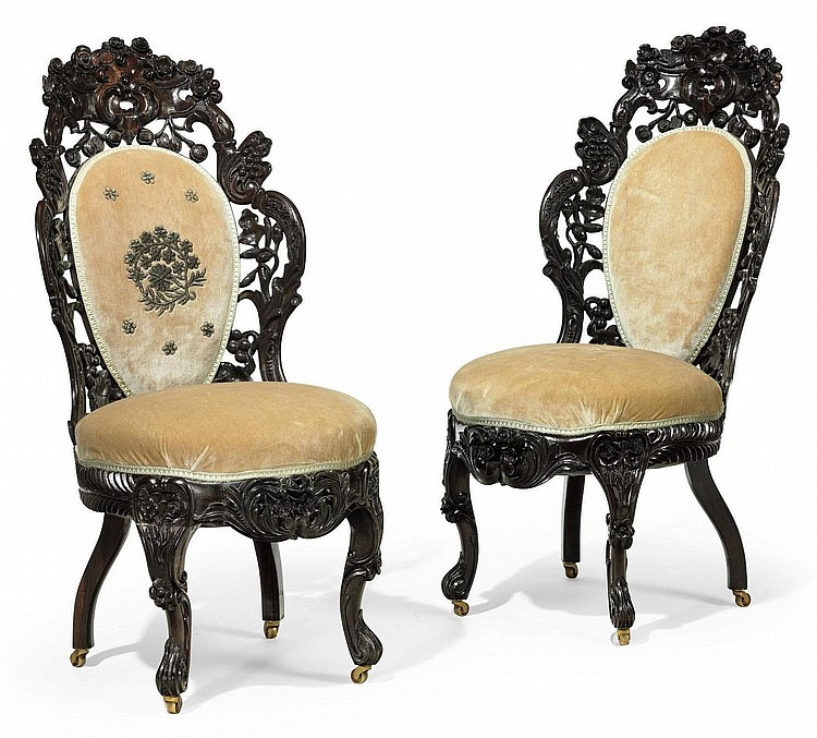 A PAIR OF ROCOCO REVIVAL CARVED AND LAMINATED ROSEWOOD SIDE CHAIRS