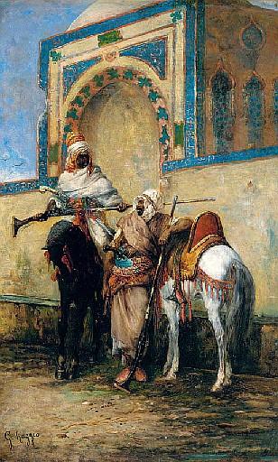 Arab horsemen resting outside a mosque