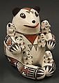 Acoma pottery storyteller figure