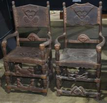 (lot of 2) Pair of African carved wood armchairs, 42
