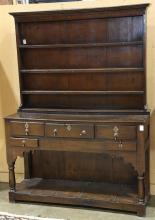 Welsh stepback cupboard, 19th century, the superstructure having (3) fixed shelves, above the five drawer case, rising on turned sup...
