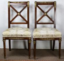 (lot of 2) French Empire partial gilt mahogany chairs, each with back having a X-form centered with a figural medallion, above an up...