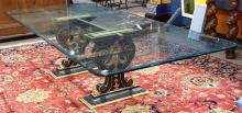 Italian Rococo style ebonized and partial gilt dining table