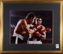 Framed photo relating to boxing legends Ken Norton and Muhammad Ali mid-fight