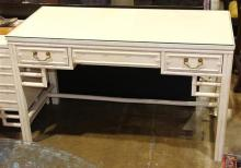 McGuire style desk, the rectangular top above the three drawer case, having a faux bamboo frame, 30