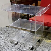 Modern lucite butler's cart, having two shelves and rising on casters, 30