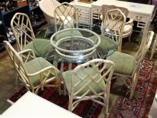 (lot of 7) McGuire style dining group, consisting of a dining table having a circular glass top above a faux bamboo frame, 29