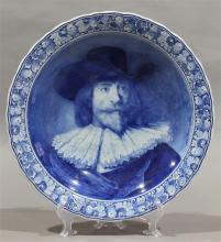 Joost Thooft & Labouchere Delft Portrait charger after Rembrandt van Rijn framed by a scalloped foliate decorated rim, 16