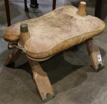 Camel  saddle, having an upholstered leather seat, 17