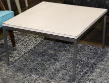 Florence Knoll occasional table, having a white laminate top above the metal frame, 16