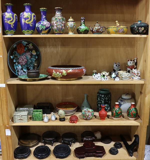 Four shelves of chinese decorative items for Shelf decor items