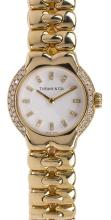 Lady's Tiffany & Co. Tesoro diamond and 18k yellow gold wristwatch