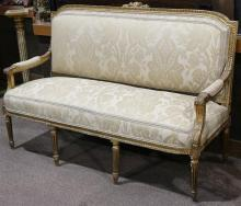 Louis XVI style giltwood carved settee circa 1870, having a shaped crest surmounting the carved frame continuing to the acanthus dec...