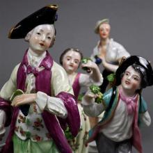 (lot of 4) Group of Continental porcelain figural groups, consisting of a Royal Vienna figural sculpture depicting a vintner, graspi...