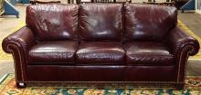 Contemporary Whittemore-Sherrill leather sofa, the three seat sofa with arms and frame having nail head accents, 36