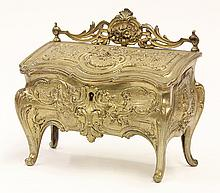 Louis XV style ormolu jewel casket, in the form of a desk, having a pierced floral crest centering an acanthus leaf above the hinged...