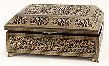 Middle Eastern pierced brass box in the Safavid style, having gilt inlay, the lid centering a cartouche with Islamic calligraphy sur...