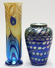 (lot of 2) Art glass group, consisting of a Lundberg Studios cylindrical from vase executed in a peacock feather design in teal, cob...