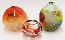 (lot of 2) Art glass group in the Moderne taste, consisting of a Herb Babcock low vase in clear glass with ruby, orange, and brown a...