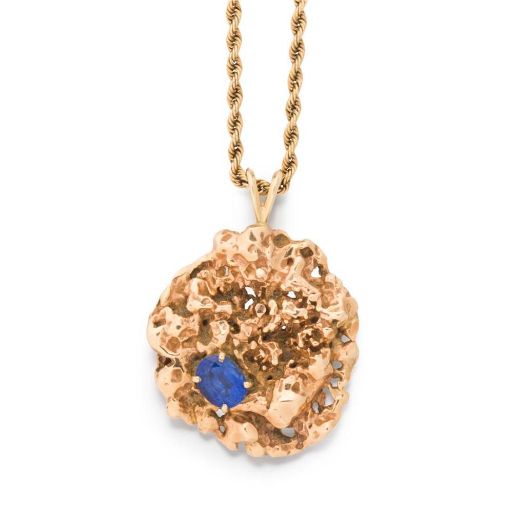 A sapphire and fourteen karat gold pendant necklace