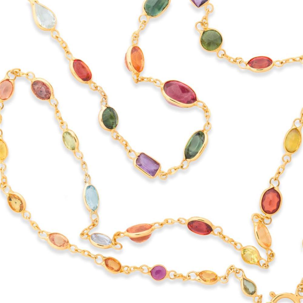 A multi-hued sapphire and eighteen karat gold necklace