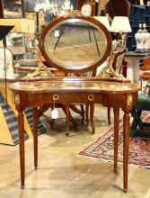 French Neoclassical style ormolu mounted vanity circa 1900, the adjustable oval looking glass flanked by  gilt bronze single-light c...