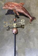 Copper weather vane, having a dolphin form top with brass directional markers, overall 46