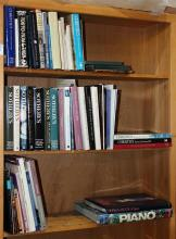 Three shelves of reference books relating to Japanese art, European monographs including Modigliani, Japanese Netsuke, Japanese prin...