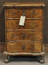Continental Baroque chest late 17th / early 18th century, having a shaped top above the four drawer case and rising on turned legs, ...