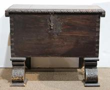 Continental Gothic Revival style coffer, circa 1870, having a hinged top, with iron hardware, and rising on carved legs, 19