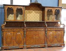 Massive Louis XV style inlaid buffet, having a shaped top centered with a wreath crest above the four door superstructure, having sc...