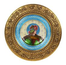 French enamel decorated plaque, depicting a young beauty in profile, having a turquoise and partial gilt border, signed  Dorval, and...
