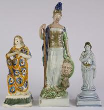 (lot of 3) Staffordshire Pearlware female figures 18th / 19th century, the first draped figure standing with her arms resting across...