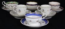 (lot of 12) Crown Derby soft paste cup and saucer group, 1758-1830, each having partial gilt reserves and floral accents, two with g...