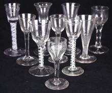 (lot of 10) Collection of British and Dutch wine and champagne glasses, 18th century, some having opaque twist stems, others with pl...