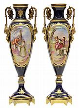 Pair of French Sevres style porcelain urns