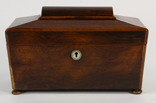 English rosewood tea caddy, 19th Century, the casket form case with mother of pearl escutcheon, opening to a fitted interior and ris...