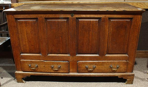English Georgian blanket chest circa 1800, executed in oak, the two planked lids with internal hinges, above the paneled front over...