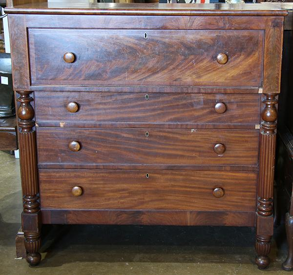 Empire mahogany border''s chest, having a rectangular top, above the four drawer case flanked with reeded pilasters, 48