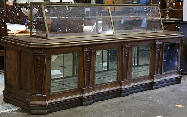 Art Deco quartersawn oak display case, 19th century, having a brass frame cake protector with inset glass panels, 34