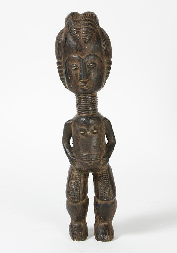 Baule, Ivory Coast carved female doll natualistically depicted with styled hair, delicated facial features, body jewelry and scarifi...