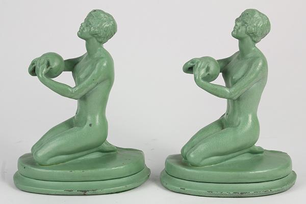 Bradley & Hubbard Art Deco style figural bookends, depicting a nude kneeling and holding a ball, 6